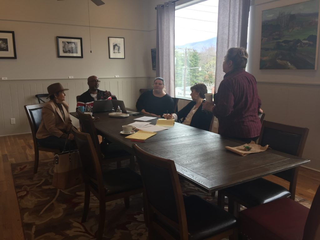 During one of the first meetings for the UNITY project, John Wilkins meets with a team from TFAC & the community to plan the new project.