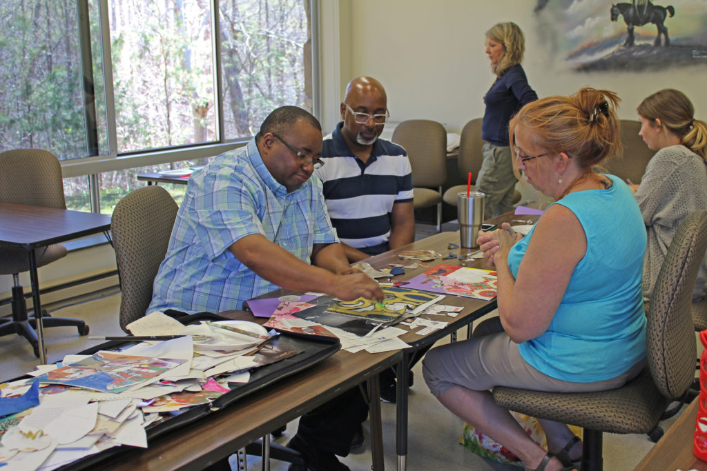 Artist Eric McRay works with community members to complete collages